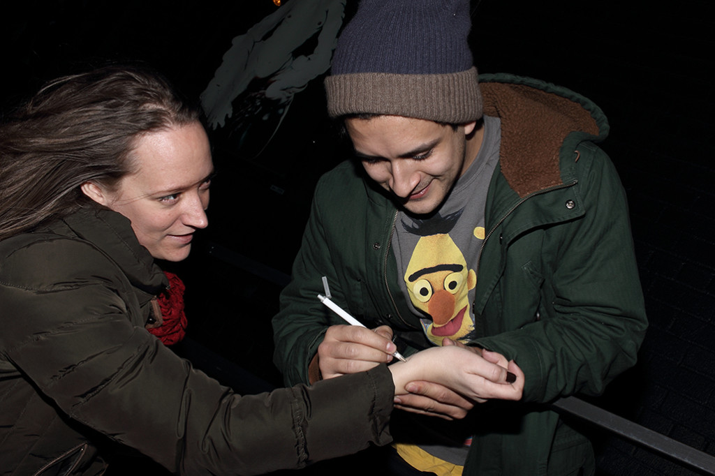 One of the guys from Folding Legs signing and aoutograph