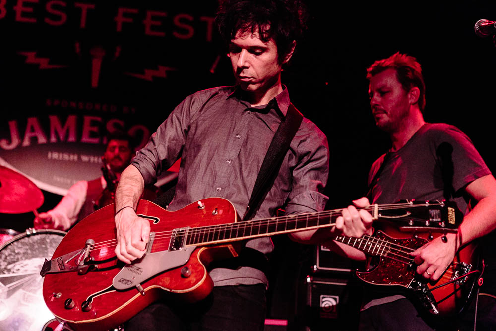 Nick Zinner and Donald Cumming performing
