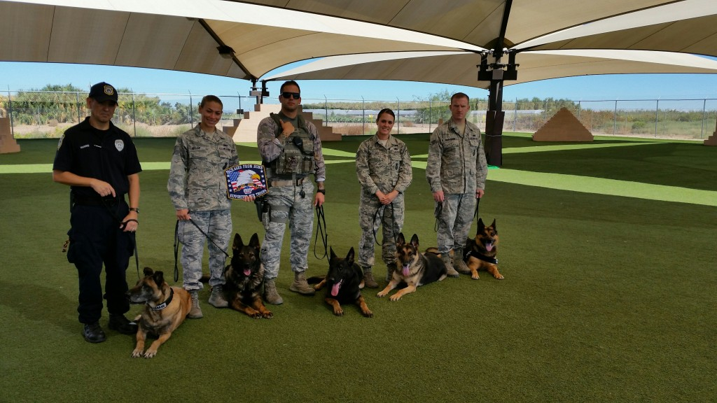 PHOENIX: Pictured here are: Officer Richard Harris with MWd Dyngo, Jessie Keller with MWD Crach, SSgt Justin Gonzalez with MWD Rango, SSgt Mariah Langeland with MWD Wax, and SrA Sean Mcfadden with MWD Maxo