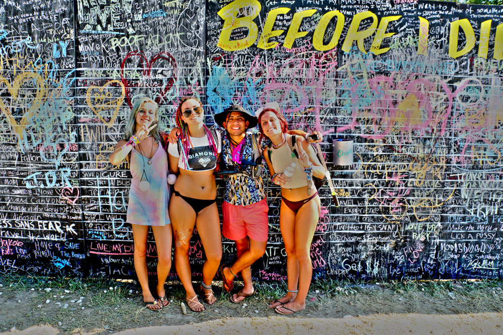 """In front of the """"Before I die"""" wall"""